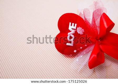 Red heart with love word  decorate with ribbon on paper