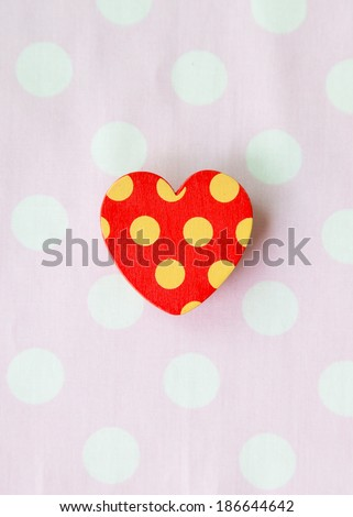 Red heart with pink white polka dot background