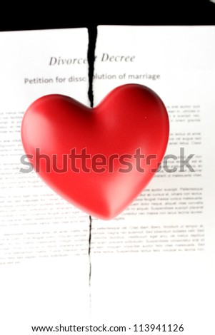 red heart with torn Divorce decree document, on black background close-up - stock photo