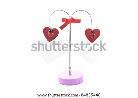 red hearts and a slip of paper on a clothes pin on white background