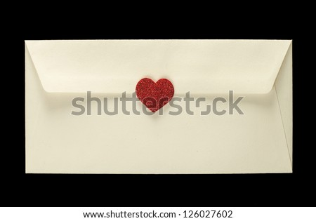 Red hearts and white envelope on wooden background