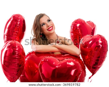 red hearts and woman looking up - stock photo