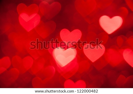 red hearts bokeh as background - stock photo
