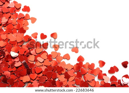 Red hearts confetti on white background - stock photo