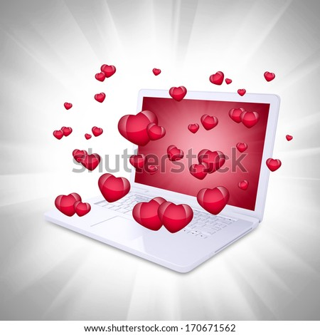 Red hearts fly out of the laptop. Computer technology concept on Valentine's Day