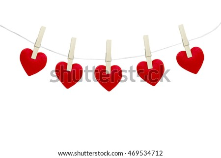 Red hearts hanging on white background