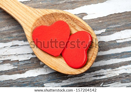 red hearts in wooden spoon - stock photo