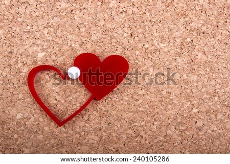 Red hearts note on cork bulletin board - Valentine or other reminder. - stock photo