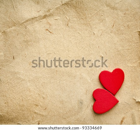 red hearts on vintage  paper background with copyspace - stock photo