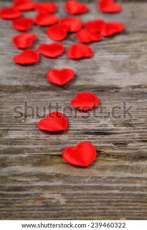 Red hearts on wooden background. Valentines day background.