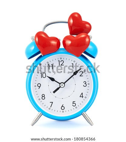 Red hearts over the blue alarm clock isolated over the white background