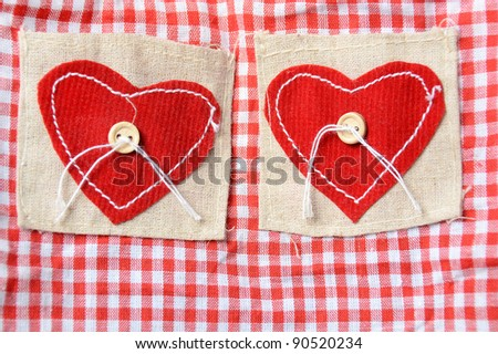 red hearts. red white squares background