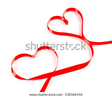 Red hearts ribbon isolated on white
