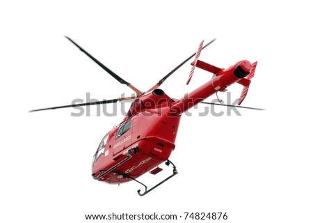 Red helicopter of air ambulance isolated on white background, London - UK - stock photo