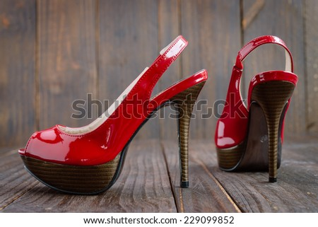 Red high heel on wooden background - vintage effect style pictures