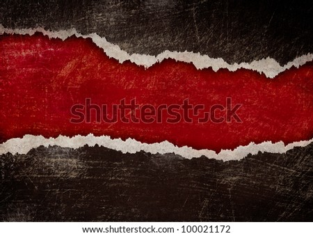 red hole with torn edges in black grunge paper - stock photo