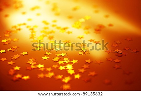Red holiday background with shiny gold stars, Christmas ornament and new year decoration - stock photo
