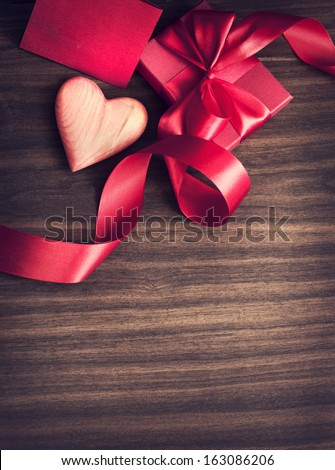 REd Holidays gift and heart on wooden background/ Valentines day background - stock photo