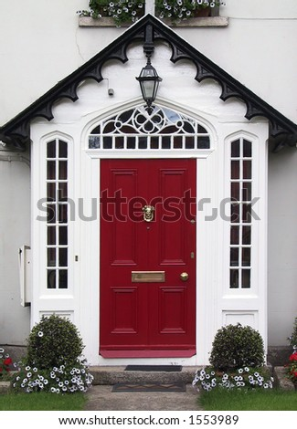 Red home door (Ireland). - stock photo