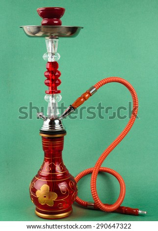 Red hookah on a green background