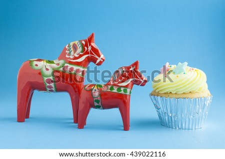 Red horse model with cup cake - stock photo