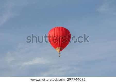 Red hot air balloon with a sky blue background
