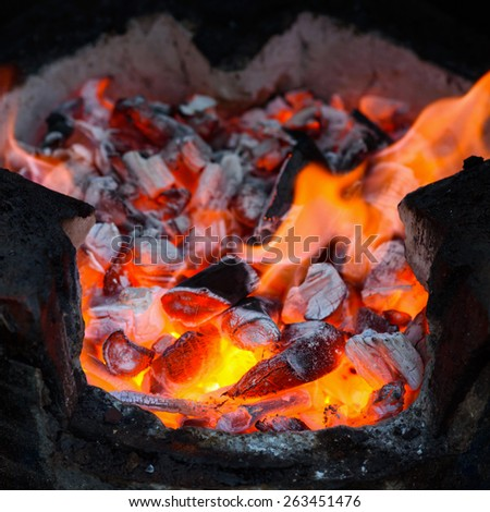 Red hot  burning charcoal background with fire - stock photo