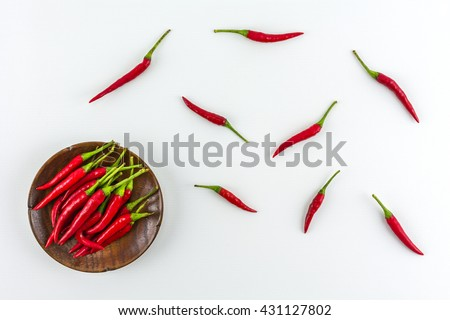 Red Hot chili On a white background./ Red hot chili peppers isolated on white background./ Red hot chili peppers on a wooden plate - stock photo