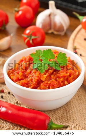 Red hot chili pepper and ingredients for sauce and sauce - stock photo