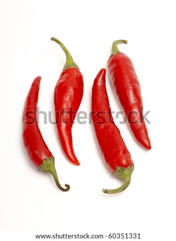 Red hot chili peppers isolated on white.