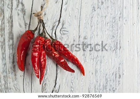 Red hot chili peppers on white wooden table