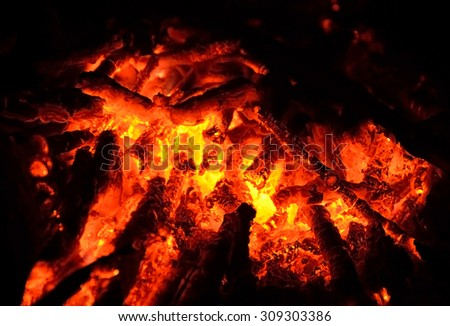 Red hot coals after fbonire at night. - stock photo