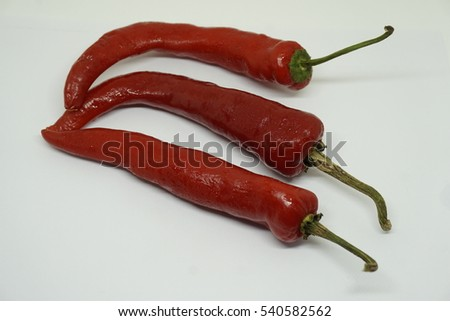 Red hot natural chili pepper pod realistic image for culinary products on a white background