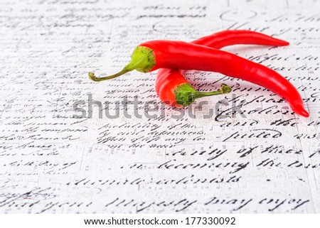 Red hot pepper on a light background with the words - stock photo
