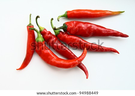 Red hot peppers on white background - stock photo