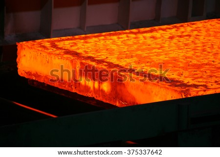 red-hot steel slab heated in the furnace - stock photo