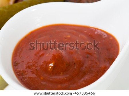 Red hot tomato sauce for roast pork ribs. Macro. Photo can be used as a whole background.
