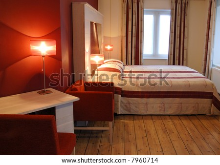 Red hotel room - stock photo