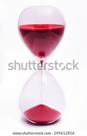 Red hourglass on white background. - stock photo
