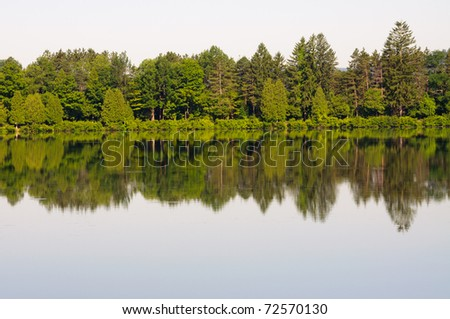 Red House Lake and a green forest - stock photo