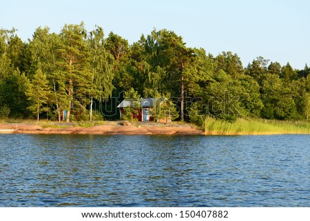 Red house on the rocky shore. Aland Islands, Finland