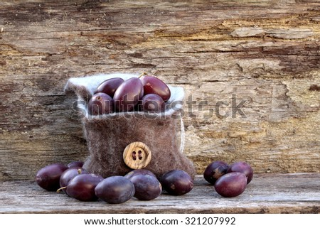 red house plums in a bag - stock photo