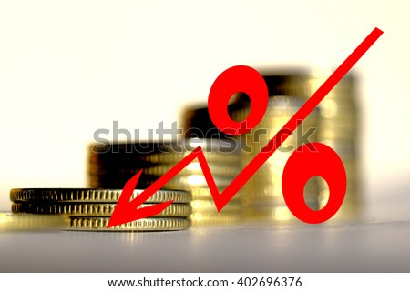 Red icon of interest on the background of coins - stock photo