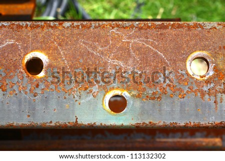 Red iron rust holes. - stock photo
