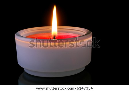 Red (isolated)  lighted candle in black background - stock photo