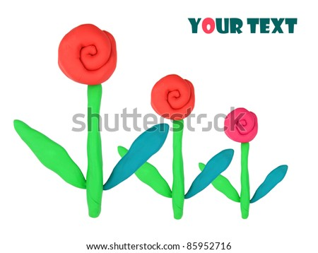 red isolated plasticine flowers on the white background - stock photo