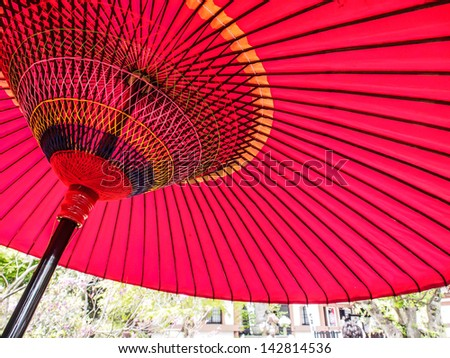 red Japanese paper umbrella - stock photo