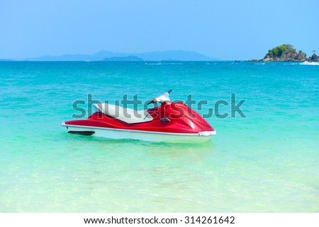 Red Jet ski on the beach of Andaman Sea in summer vacation at Khai Nok island Phang Nga, Thailand. - stock photo