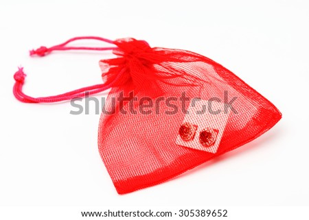 red jewelry bag on white background. - stock photo