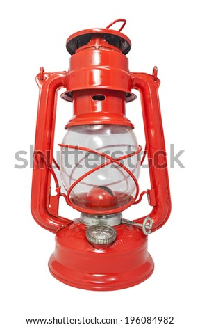 Red kerosene lamp from Czechoslovakia isolated on white background. - stock photo